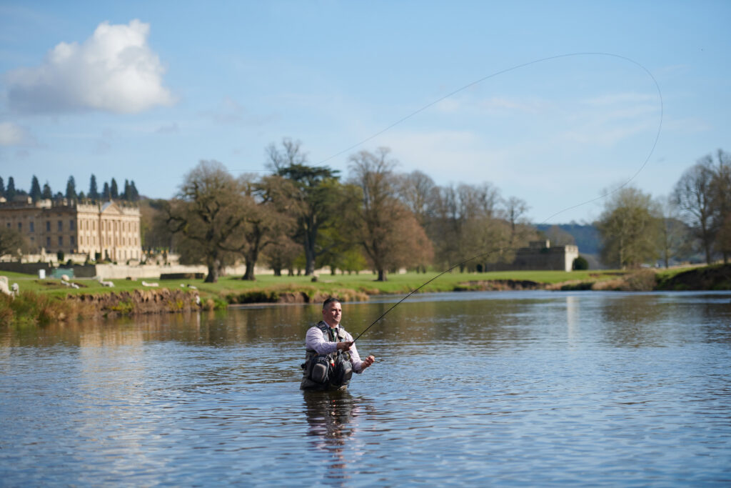 Fisherman casts his line on the Chatsworth Estate